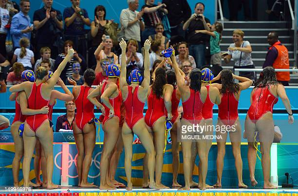 Spain's Water Polo team celebrates after winning the women's Water Polo Semifinal Round match between Hungary and Spain at the London 2012 Olympic...