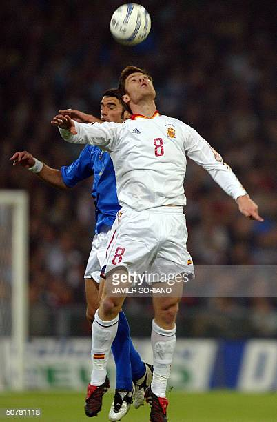 Spain's Xabi Alonso fights for the ball with Italy's Simone Perrotta during a preEuro 2004 football friendly match at Luigi Ferraris stadium of Genoa...