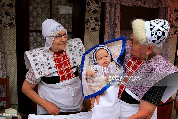 Spakenburg is one of the few places left in the Netherlands where some women still wear local traditional clothes. A grandmother showing her...