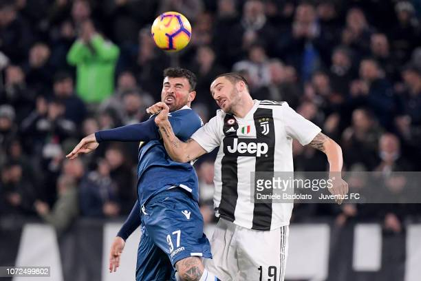 Spal player Andrea Petagna and Juventus player Leonardo Bonucci during the Serie A match between Juventus and SPAL on November 25 2018 in Turin Italy