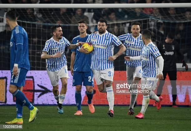 Spal's Italian forward Andrea Petagna celebrates next to Juventus' Portuguese forward Cristiano Ronaldo after scoring a penalty during the Italian...