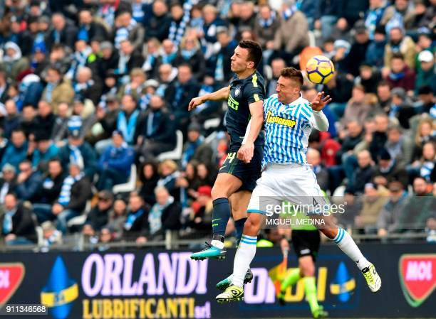 TOPSHOT Spal's Italian midfielder Mariano Arini fights for the ball with Inter Milan's Croatian forward Ivan Perisic during the Italian Serie A...
