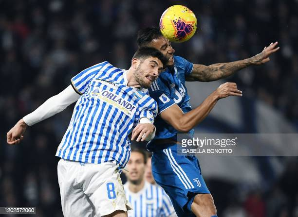 Spal's Italian midfielder Mattia Valoti and Juventus' Brazilian defender Danilo go for a header during the Italian Serie A football match SPAL vs...