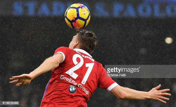 Spal's Polish defender Bartosz Salamon jumps for the ball during the Serie A football match between Napoli and Spal at San Paolo Stadium Stadium in...