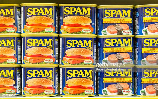 Spam canned meat stacked vertically in store shelf Spam is a brand of canned precooked meat products made by Hormel Foods Corporation