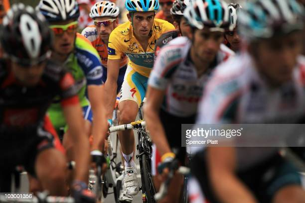 Spaniard Alberto Contador in the yellow jersey rides up a climb during stage 16 of the Tour de France on July 20 2010 in Pau France The stage between...