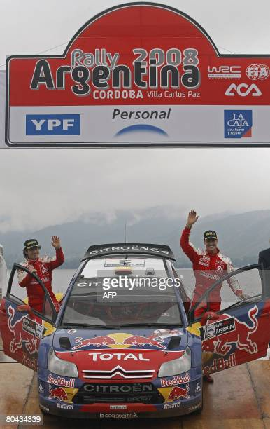 Spaniard Dani Sordo and codriver Marc Marti wave during the podium ceremony of the FIA World Rally Championship in Argentina in Carlos Paz city 756...