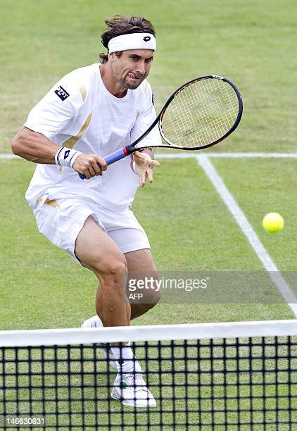 Spaniard David Ferrer returns the ball to Dutch Igor Sijsling on June 21 2012 during their quarterfinal match of the sHertogenbosch grasscourt...