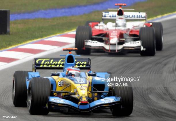 Spaniard Fernando Alonso in the Renault leads Italian Jarno Trulli in a Toyota during the Formula One Malaysian Grand Prix at the Sepang...
