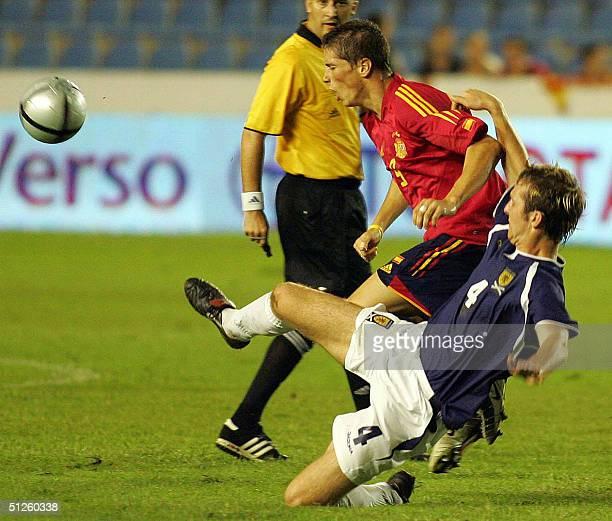 Spaniard Fernando Torres vies with Webster of Scotland during a friendly match in Ciudad de Valencia Stadium in Valencia 03 September 2004