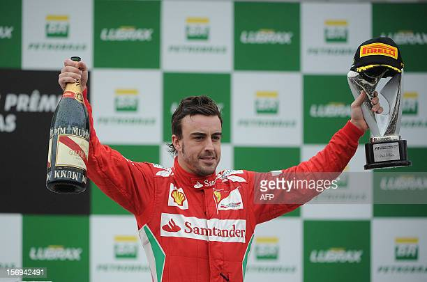 Spaniard Formula One driver Fernando Alonso celebrates his second place on the Brazil's F-1 GP during the podium ceremony at the Interlagos race...