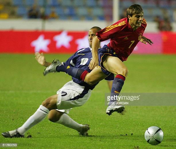 Spaniard Joaquin vies with Quasihe of Scotland in a friendly match in Ciudad de Valencia Stadium in Valencia 03 September 2004