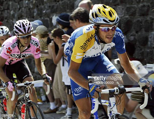Spaniard Juan Miguel Mercado rides in front of German Jorg Jaksche during the seventh stage of the 90th Tour de France cycling race between Lyon and...
