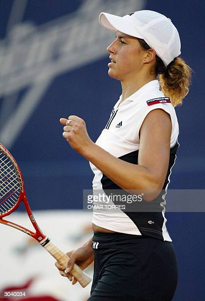 Spaniard Marta Marrero celebrates after winning the first set of the game against Amanda Coetzer of South Africa in the second round tennis match of...