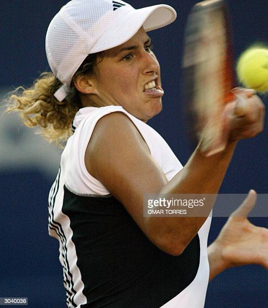 Spaniard Marta Marrero returns the ball during her game against Amanda Coetzer of South Africa in the second round tennis match of the Mexican Open...