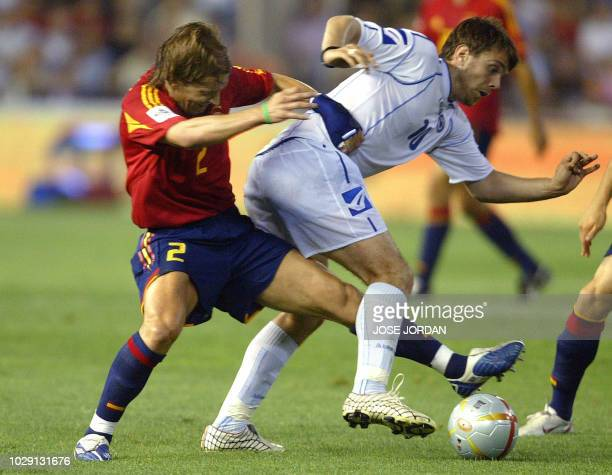 Spaniard Michel Salgado fights for the ball with Bosnian Misimovic Zujezdan during their soccer match in a World Cup 2006 football qualifier at...
