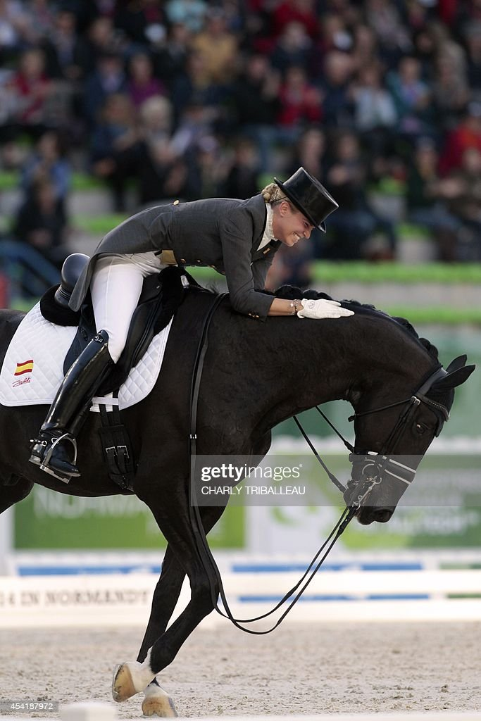Spaniard Morgan Barbancon rides Painted Black on August 26, 2014 during the second session of the Dressage Grand Prix of the 2014 FEI World Equestrian Games at D'Ornano Stadium in the northwestern French city of Caen. TRIBALLEAU