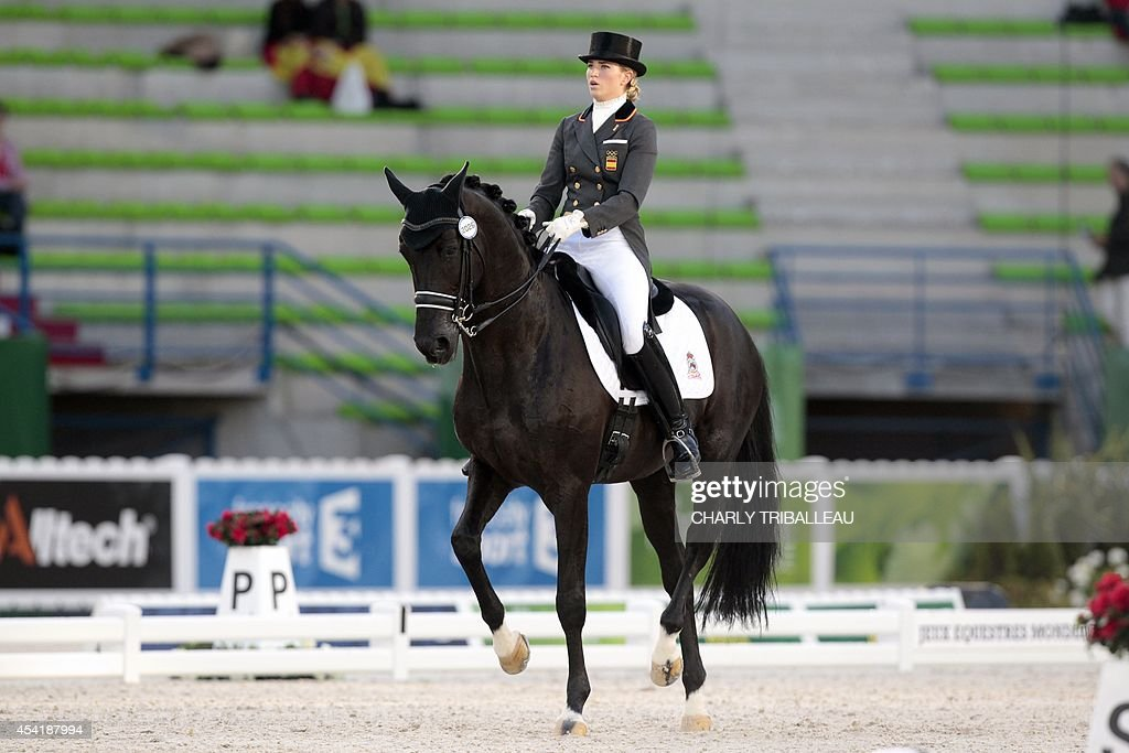 Spaniard Morgan Barbancon rides Painted Blackon August 26, 2014 during the second session of the Dressage Grand Prix of the 2014 FEI World Equestrian Games at D'Ornano Stadium in the northwestern French city of Caen. TRIBALLEAU