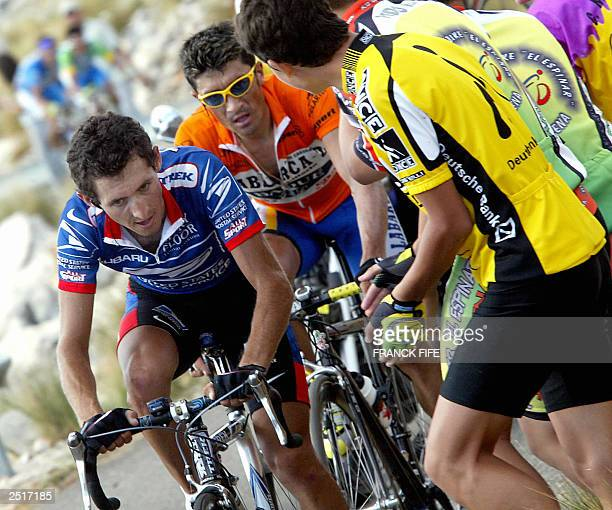 Spaniard Roberto Heras and Colombian Felix Cardenas ride during the 15th stage of the 58th Tour of Spain cycling race between Valdepenas and Sierra...