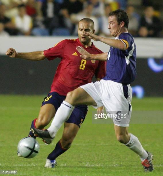 Spaniard Ruben Baraja vies with Ferguson of Scotland during a friendly match in Ciudad de Valencia Stadium in Valencia 03 September 2004.