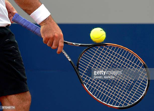 Spaniard Santiago Ventura balances the ball before serving to countryman Juan Carlos Ferrero during their ATP quarterfinals match at Lawn Tennis Club...