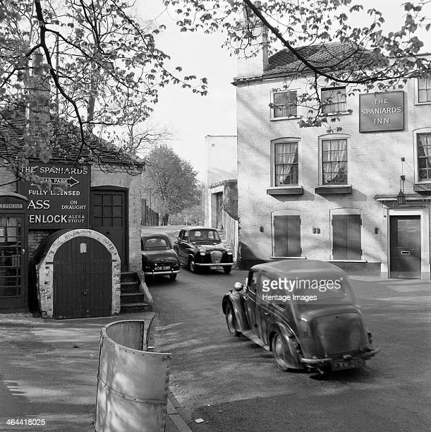 Spaniards Inn Spaniards Road Hampstead Heath London 19601965 Cars passing each other on the road between the Spaniards Inn and the old Toll House at...