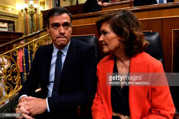 Spanish acting Prime Minister Pedro Sanchez and Deputy Prime Minister and minister of equality Carmen Calvo attend a parliament plenary session on...