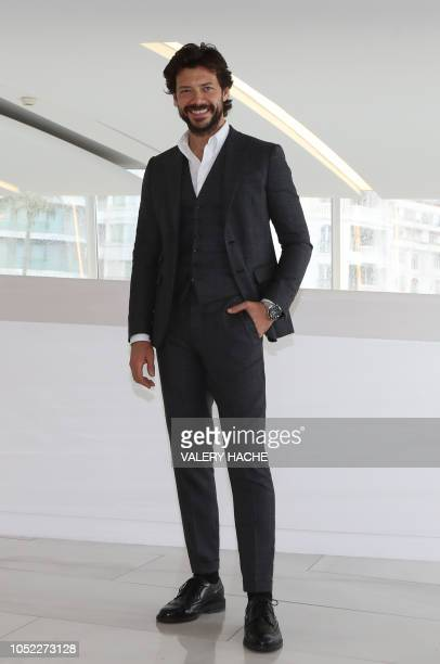 Spanish actor Alvaro Morte poses during a photo call for the TV series 'The Pier' as part of the MIPCOM on October 16 2018 in Cannes southeastern...
