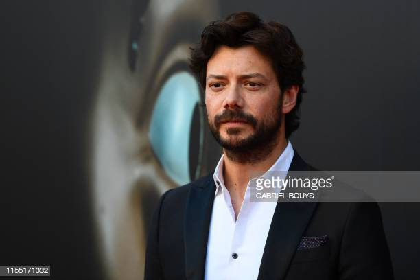 Spanish actor Alvaro Morte poses during a photocall for the presentation of Spanish TV show La Casa de Papel 3rd season on July 11 2019 in Madrid