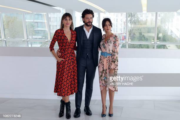 Spanish actor Alvaro Morte poses with actress Irene Arcos and Spanish actress Veronica Sanchez during a photocall for 'The pier' TV series as part of...