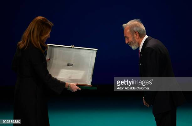 Spanish actor and director Jose Luis Gomez receives the medal on hands of President of Andalusia Susana Diaz during the Medal of Andalucia awards...