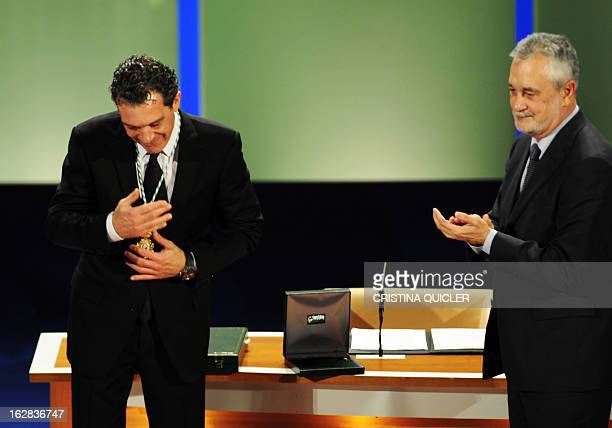 Spanish actor Antonio Banderas aknowledges applause after receiving the title of Favorite Son of Andalucia from Andalucia's regional president Jose...