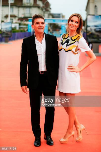 Spanish actor Antonio Banderas and his companion Nicole Kimpel arrive for the screening of 'The Music of Silence' on September 6 2017 during the 43rd...