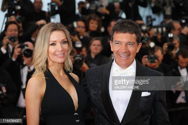 TOPSHOT Spanish actor Antonio Banderas and his partner Nicole Kimpel pose as they arrive for the screening of the film Dolor Y Gloria at the 72nd...