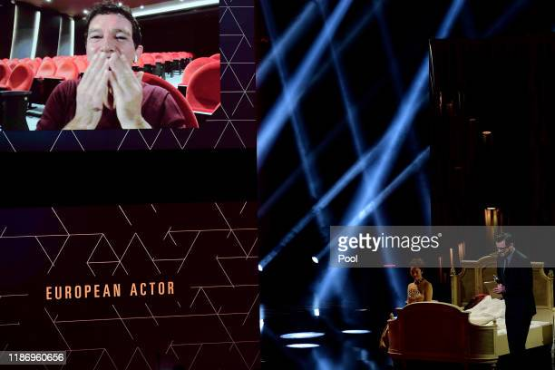 Spanish actor Antonio Banderas is seen on a big screen as he thanks the participants after being awarded Best European Actor during the 32nd European...