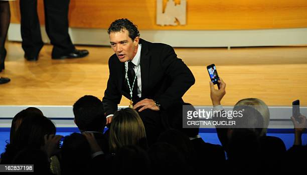 Spanish actor Antonio Banderas poses after receiving the title of Favorite Son of Andalucia during a ceremony at the Maestranza Theatre in Sevilla on...