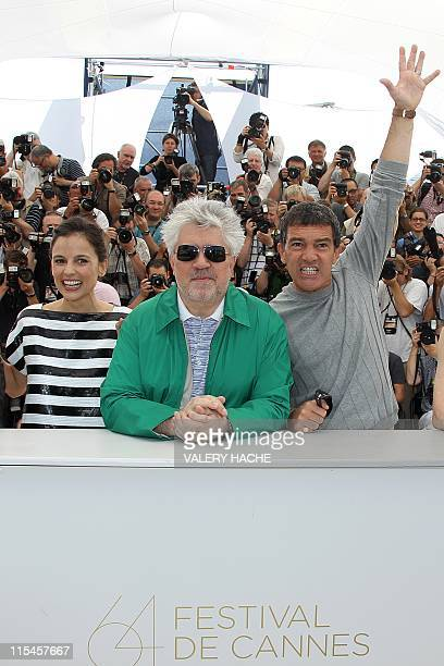Spanish actor Antonio Banderas Spanish director Pedro Almodovar and Spanish actress Elena Anaya pose during the photocall of 'La Piel Que Habito'...