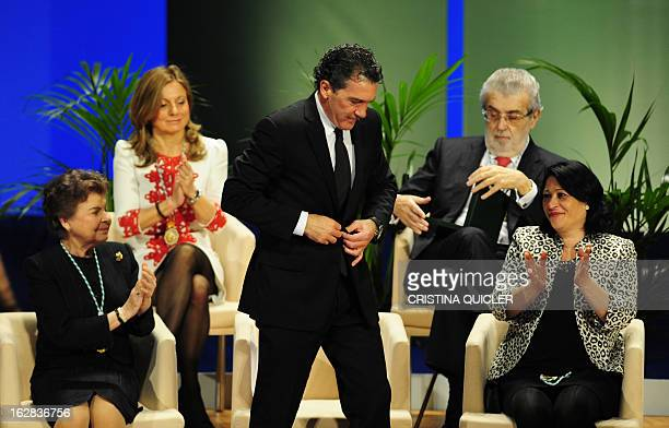 Spanish actor Antonio Banderas stands up to receive the title of Favorite Son of Andalucia from Andalucia's regional president Jose Antonio Grinan...