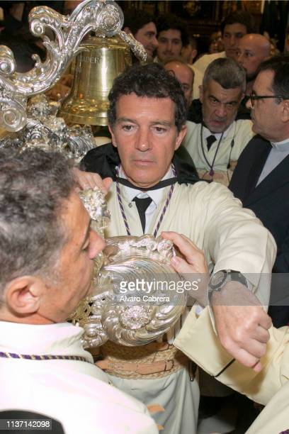 Spanish actor Antonio Banderas takes part in the Lagrimas y Favores brotherhood's Palm Sunday procession during Holy Week on April 14 2018 in Malaga...