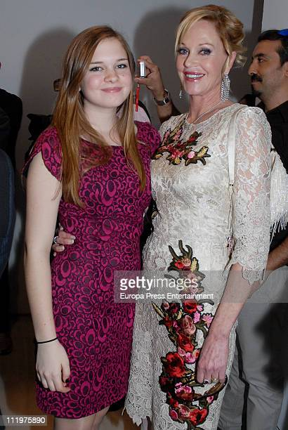Spanish actor Antonio Banderas' wife Melanie Griffith and his daughter Stella del Carmen attend the announcement of the opening of the Malaga Holy...