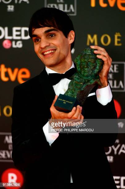 Spanish actor Eneko Sagardoy poses after receiving the best new actor award for 'Handia' at the 32nd Goya awards ceremony in Madrid on February 3...