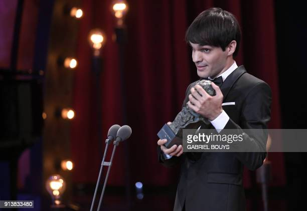 Spanish actor Eneko Sagardoy receives the best new actor award for 'Handia' at the 32nd Goya awards ceremony in Madrid on February 3 2018 / AFP PHOTO...