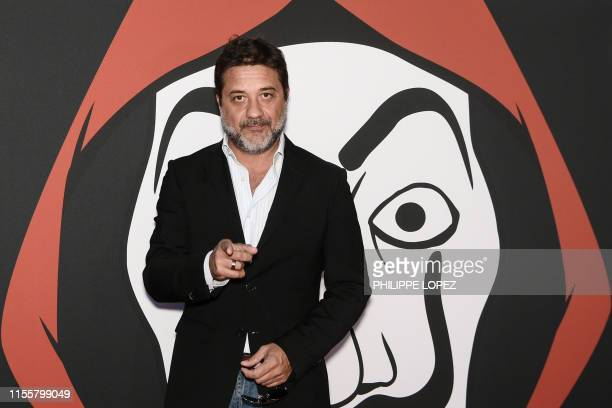 Spanish actor Enrique Arce poses during a photocall for the presentation of Spanish TV show La Casa de Papel 3rd season on July 15 2019 in Paris
