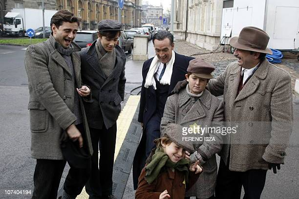 Spanish actor Francis Lorenzo who plays the part of Angel Sanz Briz shares a joke with fellow actors Asier Etxeandia Gergo Csiby and Italian actor...