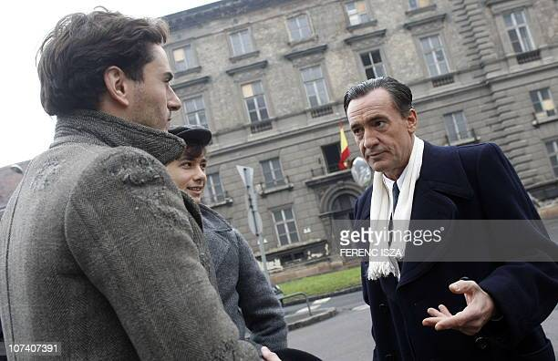 Spanish actor Francis Lorenzo who plays the part of Angel Sanz Briz chats with fellow actors Asier Etxeandia and Gergo Csiby on the set of a joint...