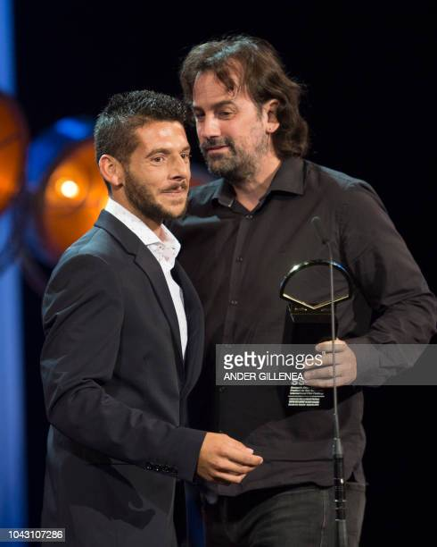 Spanish actor Israel Gomez and director Isaki Lacuesta receive the 'Concha de Oro' best film award for the film 'Entre dos aguas' during the 66th San...