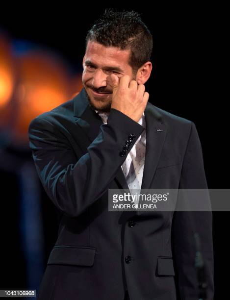 Spanish actor Israel Gomez cries after the film 'Entre dos aguas' received the 'Concha de Oro' best film award during the 66th San Sebastian Film...