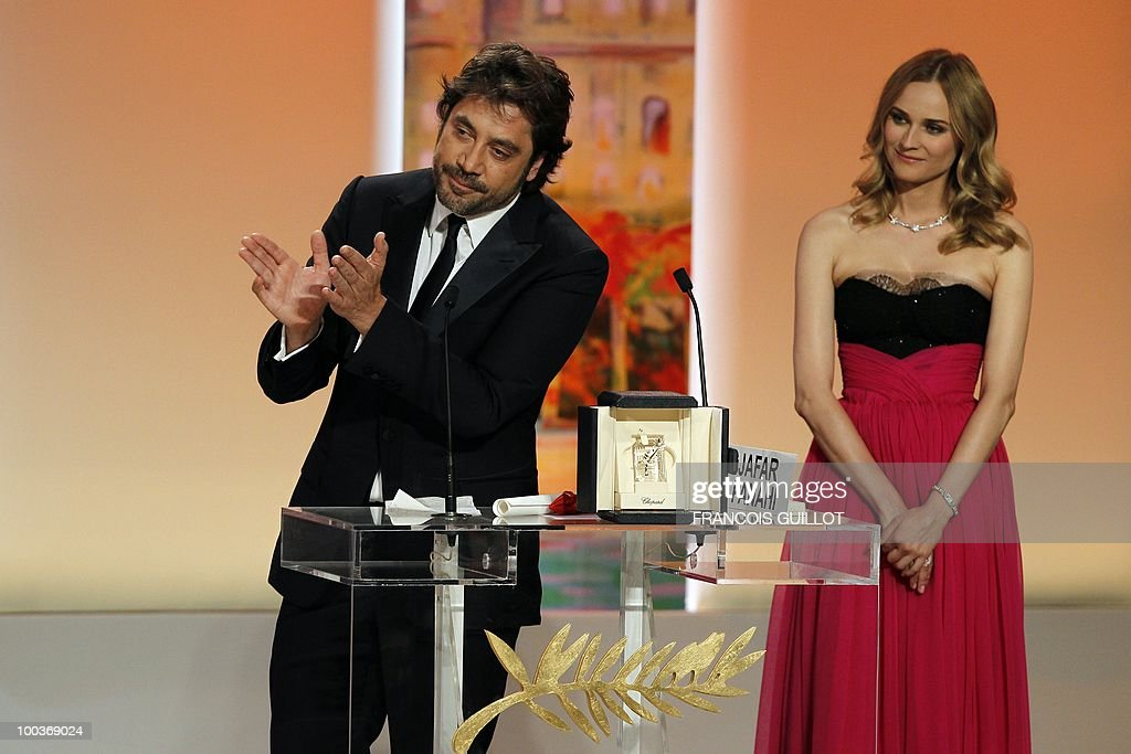 Spanish actor Javier Bardem poses next to German actress Diane Kruger after winning the Best Actor award for his role in 'Biutiful' during the closing ceremony at the 63rd Cannes Film Festival on May 23, 2010 in Cannes.