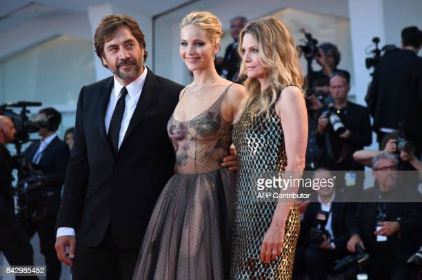 Spanish actor Javier Bardem US actress Jennifer Lawrence and US actress Michelle Pfeiffer attend the premiere of the movie 'Mother' presented in...