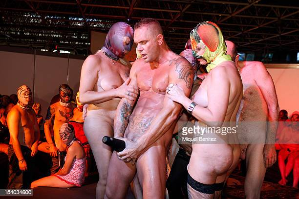 Spanish actor Nacho Vidal performs the Babylon Opera with La Fura dels Baus at the Barcelona Erotic Fair on October 12 2012 in Barcelona Spain